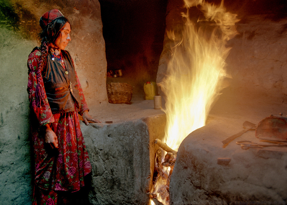 Shah Begun, a Wakhi woman from Sherk, starts the evening fire to bake Nan bread for dinner. Nan bread and milk is the standard dinner in summer in the Wakhan, one of Afghanistan's poorest region.<br /> <br /> Adventure through the Afghan Pamir mountains, among the Afghan Kyrgyz and into Pakistan's Karakoram mountains. July/August 2005. Afghanistan / Pakistan.