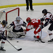 Sammy Davis, Boston University, challenges UConn goal tender goal Annie Belanger during the UConn Vs Boston University, Women's Ice Hockey game at Mark Edward Freitas Ice Forum, Storrs, Connecticut, USA. 5th December 2015. Photo Tim Clayton