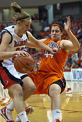 28 March 2010: Katie Broadway is assessed an offensive foul as she drives in against a moving Kersten Magrum. The Redbirds of Illinois State squeak past the Illini of Illinois 53-51 in the 4th round of the 2010 Women's National Invitational Tournament (WNIT) on Doug Collins Court inside Redbird Arena at Normal Illinois.