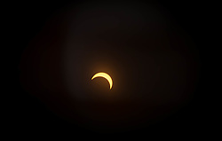 View of the partial solar eclipse from NASA's Goddard Space Flight Center in Greenbelt, Md on Monday, August 21, 2017. <br /> <br /> A total solar eclipse swept across a narrow portion of the contiguous United States from Lincoln Beach, Oregon to Charleston, South Carolina. A partial solar eclipse was visible across the entire North American continent along with parts of South America, Africa, and Europe.  <br /> <br /> Credit: NASA/Goddard/Rebecca Roth  Please note: Fees charged by the agency are for the agency's services only, and do not, nor are they intended to, convey to the user any ownership of Copyright or License in the material. The agency does not claim any ownership including but not limited to Copyright or License in the attached material. By publishing this material you expressly agree to indemnify and to hold the agency and its directors, shareholders and employees harmless from any loss, claims, damages, demands, expenses (including legal fees), or any causes of action or allegation against the agency arising out of or connected in any way with publication of the material.