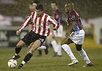 Photo Aidan Ellis.<br /> Burnley v Sunderland.<br /> Coca-Cola Championship.<br /> Turf Moor, Burnley.<br /> 04/03/2005.<br /> Sunderland's Michael Bridges and Burnley's Frank Sinclair in action in the snow at Burnley