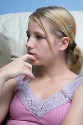 Teenage girl sitting on the sofa,