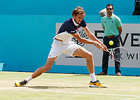 Tennis - 2019 Queen's Club Fever-Tree Championships - Day Six, Saturday<br /> <br /> Men's Singles, Semi Final: Daniil Medvedev (RUS) Vs. Gilles Simon (FRA) <br /> <br /> Daniil Medvedev (RUS) attempts to reach the backhand <br /> on Centre Court.<br />  <br /> COLORSPORT/DANIEL BEARHAM