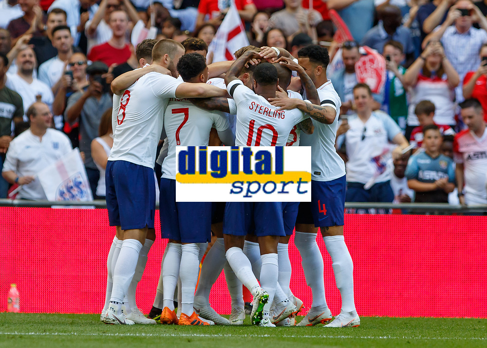 Football - 2018 International Friendly (pre-World Cup warm-up) - England vs. Nigeria<br /> <br /> England players celebrate after Gary Cahill (England) scores the opening goal at Wembley Stadium.<br /> <br /> COLORSPORT/DANIEL BEARHAM