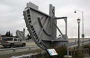Huge drawbridge gears from the old South Park Bridge have been repurposed as artwork on the newly built replacement span that opened in 2014. (Ken Lambert/The Seattle Times)