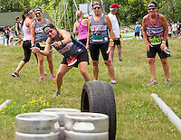 "Team Beer Crew II with Becca, Mary and Betsy watching as Gailyn tries to persuade her shot during the ""Tire Bowling"" event in the Craft Beer Relay at Gunstock Mountain Resort on Saturday.  (Karen Bobotas/for the Laconia Daily Sun)"