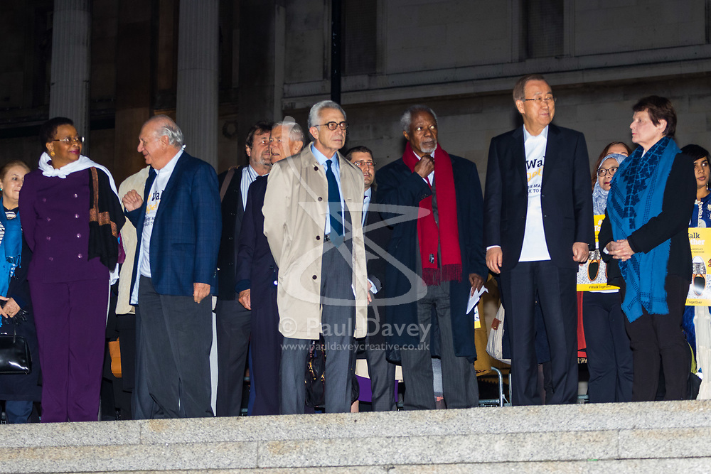 """London, October 23 2017. Nelson Mandela's group of Elders including former UN Secretary General Kofi Annan and Secretary General Ban Ki-moon accompanied by his widow Graca Machel gather at Parliament Square at the start of the Walk Together event in memory of Nelson Mandela before a candlelight vigil at his statue in Parliament Square. """"WalkTogether is a global campaign to inspire hope and compassion, celebrating communities working for the freedoms that unite us"""". PICTURED:  Former leaders including Ban Ki-moon, Kofi Annan, Mary Robinson, Gro Harlem Brundtland, Lakhdar Brahimi and Martti Ahtisaari. © Paul Davey"""
