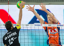 Mateusz Mika of Lotos Trefl Gdansk vs Samuel Walker of ACH during volleyball match between ACH Volley (SLO) and Lotos Trefl Gdansk (POL) in 3rd Leg of Pool F of 2016 CEV DenizBank Volleyball Champions League, on December 3, 2015 in Arena Stozice, Ljubljana, Slovenia. Photo by Vid Ponikvar / Sportida