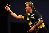 Simon Whitlock (Aus) in action against Andy Hamilton (Eng). McCoy's Premier league darts, week 7 event at the Motorpoint Arena in Cardiff, South Wales on Thursday 21st March 2013. pic by Andrew Orchard, Andrew Orchard sports photography,