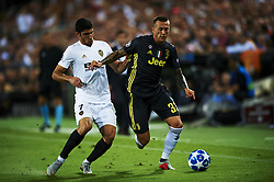 September 19, 2018 - Valencia, Spain - Guedes, Federico Bernardeschi  (R)  competes for the ball during the Group H match of the UEFA Champions League between Valencia CF and Juventus at Mestalla Stadium on September 19, 2018 in Valencia, Spain. (Credit Image: © Jose Breton/NurPhoto/ZUMA Press)