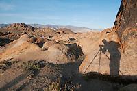 Photographer's shadow on granite boulders in the Alabama Hills, near Lone Pine, California