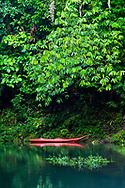 Red kayak in the Rio Agujitas near Punta Rio Claro National Wildlife Refuge, Costa Rica.