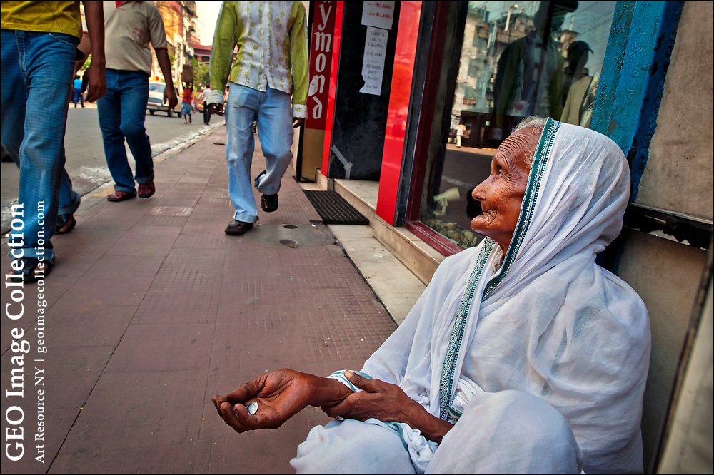 Often condemned to a life of destitution, one of India's some 50 million widows begs for money in the shadow of the Oberoi Grand Hotel in Kolkata.  A 2007 law makes it a crime for children not look after their widowed parents, but millions of widows are not aware of their rights under law, and the act provides for relatively mild penalties.