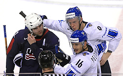 Mark Stuart (22) of USA, Mikko Koivu and Ville Peltonen (16) of Finland talking to the referee after fight at te end of ice-hockey match Finland vs USA at Qualifying round Group F of IIHF WC 2008 in Halifax, on May 11, 2008 in Metro Center, Halifax, Nova Scotia, Canada. (Photo by Vid Ponikvar / Sportal Images)