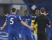 Football - 2020 / 2021 Premier League - Chelsea vs Brighton & Hove Albion - Stamford Bridge<br /> <br /> Kurt Zouma of Chelsea complains to Referee Stuart Attwell after being booked<br /> <br /> Credit : COLORSPORT/ANDREW COWIE