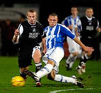 Photo: Alan Crowhurst.<br />Brighton & Hove Albion v Swansea City. Coca Cola League 1. 05/12/2006. Ian Craney (L) attacks for Swansea.