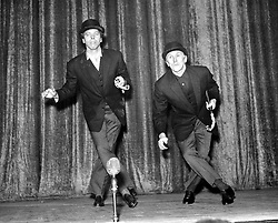 """File photo dated 24/07/58 of actors Burt Lancaster (left) and Kirk Douglas rehearsing their song and dance act in preparation for """"Night of 100 Stars """" at the London Palladium. Douglas is celebrating his 100th birthday today."""