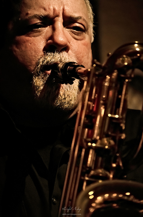Denis DiBlasio playing with other jazz musicians at his daughter's graduation party in The Bus Stop Music Cafe in Pitman, NJ.