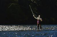 Woman fly fishing in a river in Washington USA&#xA;<br />