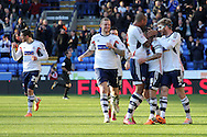 Bolton Wanderer's captain Jay Spearing is mobbed by teammates after scoring his sides third goal against Blackburn. Skybet championship match, Bolton Wanderers v Blackburn Rovers at the Reebok Stadium in Bolton, England on Saturday 1st March 2014.<br /> pic by David Richards, Andrew Orchard sports photography.