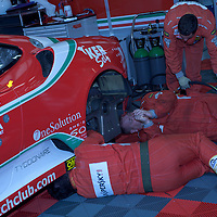 AF Corse mechanics working on #96 Ferrari F430 GTC (GT2) in the pit garage, Le Mans Series Silverstone 1000KM 2010