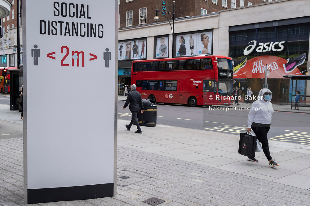 Two-metre social distancing signs advise Oxford Street shoppers to keep apart, according to government guidelines during the second wave of the UK Coronavirus pandemic, on 30th October 2020, in London, England.