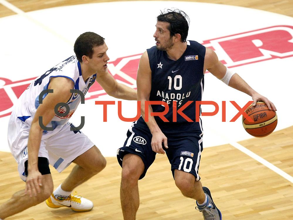 Anadolu Efes's Kerem Tunceri (R) during their Turkish Basketball league derby match  Fenerbahce Ulker between Anadolu Efes at Caferaga Sports Hall in Istanbul, Turkey, Saturday 01, 2012. Photo by TURKPIX