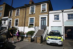 © Licensed to London News Pictures. 28/05/2020. London, UK. The crime scene at a residential property on Southgate Road, Islington, in north London. Police were called just after 8pm on Wednesday, 27 May following a domestic incident and found two pensioners - one man and a woman in their 70s suffering from stab wounds. Victims were taken to a hospital and are fighting for their lives. Photo credit: Dinendra Haria/LNP