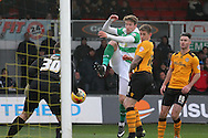 Yeovil's Ryan Bird (c) strikes the ball into the arms of Newport's keeper Joe Day. Skybet football league two match, Newport county v Yeovil Town at Rodney Parade in Newport, South Wales on Saturday 21st November 2015.<br /> pic by David Richards, Andrew Orchard sports photography.