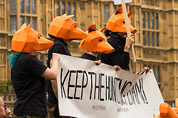 """Westminster, London, July 14th 2015. Hundreds of animal rights activists and members of hunt saboteur groups gather outside Parliament to """"Fight For THe Fox"""" as Paliament discusses an amendment to the bill outlawing fox hunting that could see the sport return to the British countryside."""