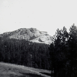 Summer 1967:  Distant view of the carving of Chief Crazy Horse Monument.  On the right is the level portion of the arm.  The hole underneath is not yet blasted away.  This project is slated to take many years...Image taken by a pre-teen boy during the year listed in caption,  scanned and adjusted in PhotoShop.  Image was shot with a Kodak Hawkeye 126 Instamatic camera..
