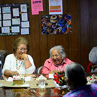 122013  Adron Gardner/Independent<br /> <br /> Annie Yazzie, center, savors a moment of humor after clan introductions at the senior center in Sawmill Friday.