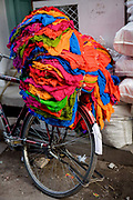 Colourful fabric hanging on a bike on 5th November 2009, in Jodhpur, Rajasthan, India.