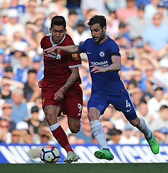 May 6, 2018 - London, Greater London, United Kingdom - Roberto Firmino of Liverpool and Cesc Fabregas of Chelsea compete for the ball during English Premier League match between Chelsea and Liverpool at Stamford Bridge, London, England on 6 May 2018. (Credit Image: © Kieran Galvin/NurPhoto via ZUMA Press)