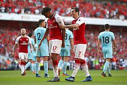 Arsenal's Alex Iwobi (left) celebrates scoring his side's fourth goal of the game with Arsenal's Henrikh Mkhitaryan