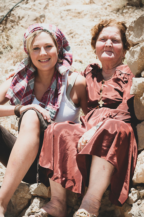 An Australian traveler and a Syrian Christian sit together on the steps leading up to Deir Mar Musa, an old monastery with frescoes dating from the 11th and 12th centuries.<br /> <br /> Deir Mar Musa was abandoned in the 19th century, but beginning in the 1980s an Italian Jesuit priest named Paolo Dall'Oglio worked to revitalize it. The monastery became a place where Muslims and Christians, backpackers and academics, might come to spend a few days, or even just a few hours. There was no charge to stay. Father Paolo was passionate about inter-religious dialogue.<br /> <br /> In 2012, two years after this picture was taken — and as the conflict in Syria escalated — Father Paolo was exiled by the Syrian government for his criticism of it. A year later he returned to Syria but was kidnapped by extremist; he is presumed dead.