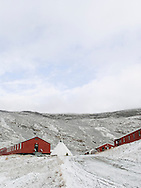 Red buildings and a tipi, Greenland