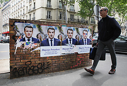 May 4, 2017 - Paris, France - A man walks by election campaign posters of French presidential election candidate for the En Marche ! movement Emmanuel Macron, ahead of the second and final round of the French presidential election on May 7. (Credit Image: © Paulo Amorim/VW Pics via ZUMA Wire)