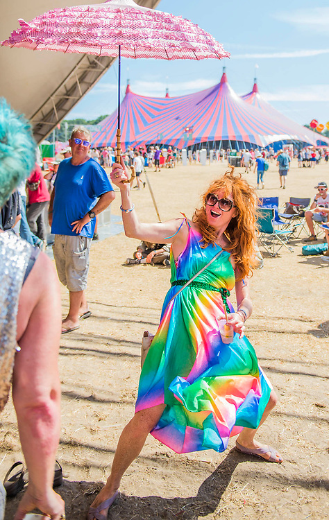 Dancing at the Lake stage with aparasol for shade - The 2018 Latitude Festival, Henham Park. Suffolk 15 July 2018