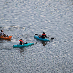 Kayakers, paddle boards and modified electric boats cruise the calm waters of Lady Bird Lake in downtown Austin on a quiet May evening. Austin continues to lead the nation in growth despite the pandemic slowdown of 2020-2021.