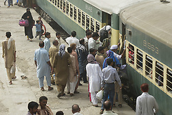 June 14, 2018 - Lahore, Punjab, Pakistan - People ride on a crowded passenger train to reach their villages and cities to celebrate the Muslim holiday festival Eid al-Fitr. Muslims around the world are preparing to celebrate the Eid al-Fitr, which marks the end of the fasting month of Ramadan. (Credit Image: © Rana Sajid Hussain/Pacific Press via ZUMA Wire)