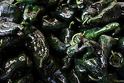 Poblano chili peppers lay in a pile on sale at a market in Mexico City, Mexico on June 12, 2008. Poblano peppers have thick walls, making them ideal for making chili relleno, or stuffed pepper, a traditional dish in Mexican cuisine originating from the city of Puebla.