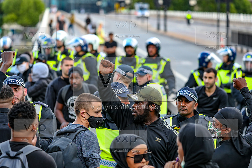 Members of Black Lives Matter movement chant slogans during a protest at Waterloo Bridge in central London, Saturday, June 13, 2020. British police have imposed strict restrictions on groups protesting in London Saturday in a bid to avoid violent clashes between protesters from the Black Lives Matter movement, as well as far-right groups that gathered to counter-protest. Anger against systemic levels of institutional racism has raged through the city, and worldwide; sparked by the death of George Floyd, who was killed in Minneapolis, US, by a policeman who restrained him with force on 25 May 2020. (Photo/ Vudi Xhymshiti)