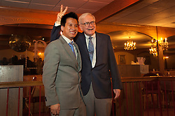 Warren Buffett poses with business students from universities around the country after at lunch at Piccolo Pete's Restaurant in Omaha, Neb., Nov. 11, 2011. Here, Buffett poses with Vu Le, 24, University of Massachusetts senior, from Vietnam.
