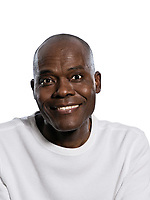 Close-up portrait of an Afro American man smiling in studio on white isolated background