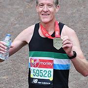London, England, UK. 28 April 2019. Chris Finill finish the Virgin Money London Marathon at Pall Mall.