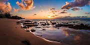 A colorful sunset over a secret beach in Hawaii