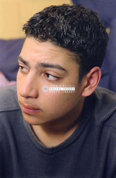 Portrait of teenage boy looking serious,