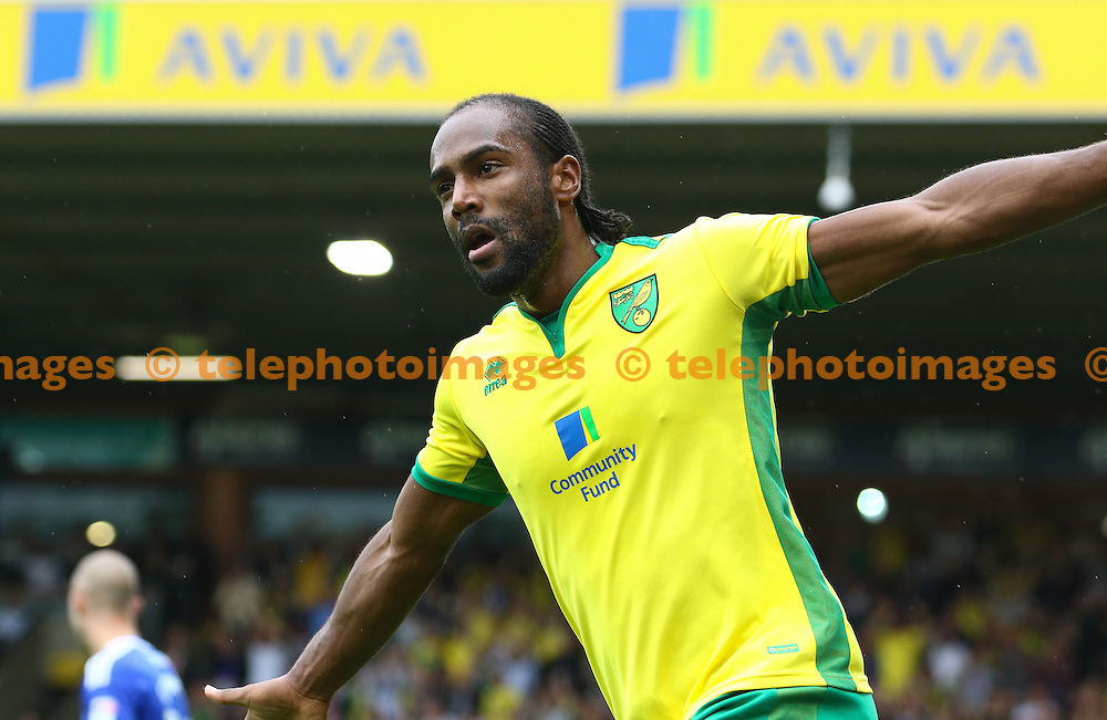 Cameron Jerome of Norwich City celebrates scoring during the Sky Bet Championship match between Norwich City and Cardiff City at Carrow Road in Norwich. September 10, 2016.<br /> Arron Gent / Telephoto Images<br /> +44 7967 642437