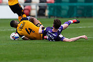 Tranmere Rover's Paul Lewis (22) kicks out on Newport County's Captain Joss Labadie (4) during the EFL Sky Bet League 2 match between Newport County and Tranmere Rovers at Rodney Parade, Newport, Wales on 17 October 2020.